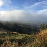 <p>Skyer og bjerge ved Manjarin</p>