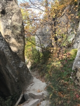 <p>																																		Limestone cliffs and narrow path</p>